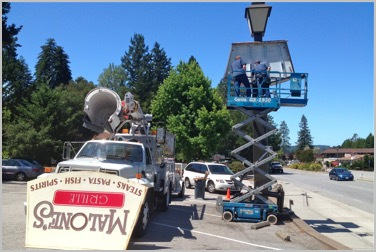 Our Boom truck and Scissors lift, retrofitting a sign